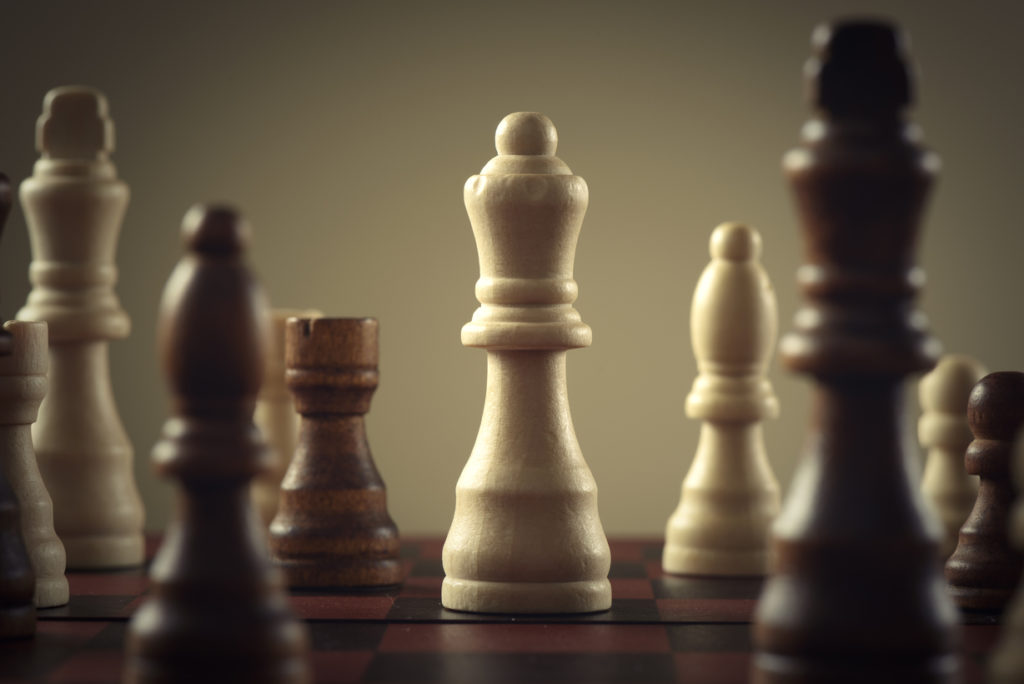 Wooden chess figures, business concept strategy