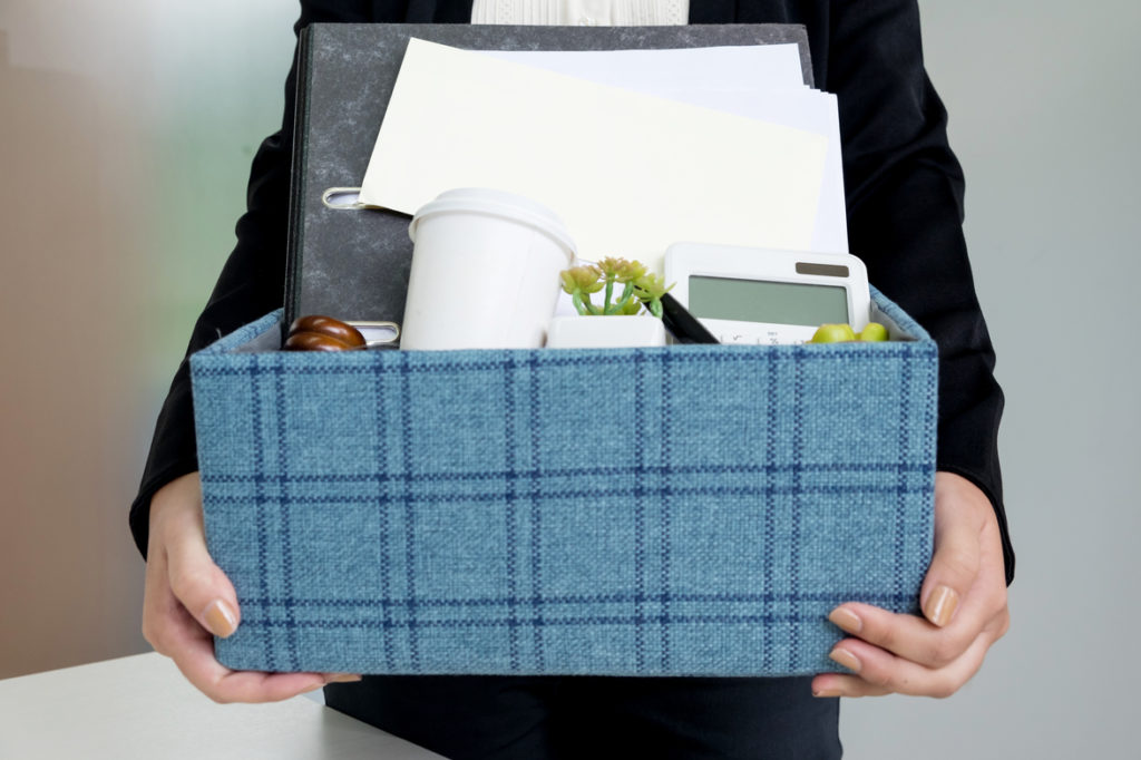 business woman packing personal company belongings when she deci
